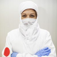 close-up portrait of worker woman with hygienic work clothes under regulations